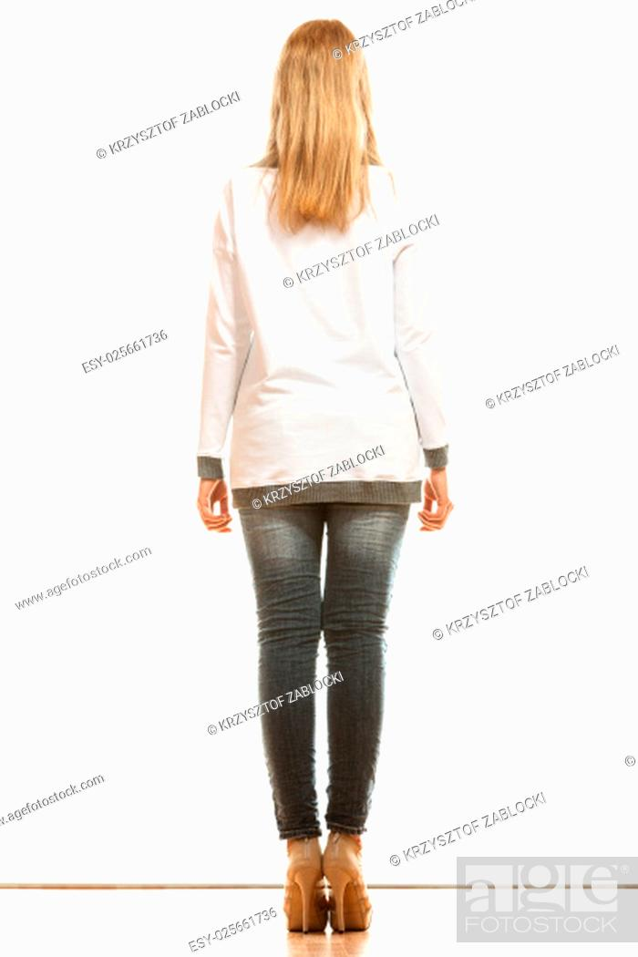 Stock Photo: fashion and people concept. woman in full length denim trousers high heels shoes casual styles of blank white blouse back view isolated on white background.