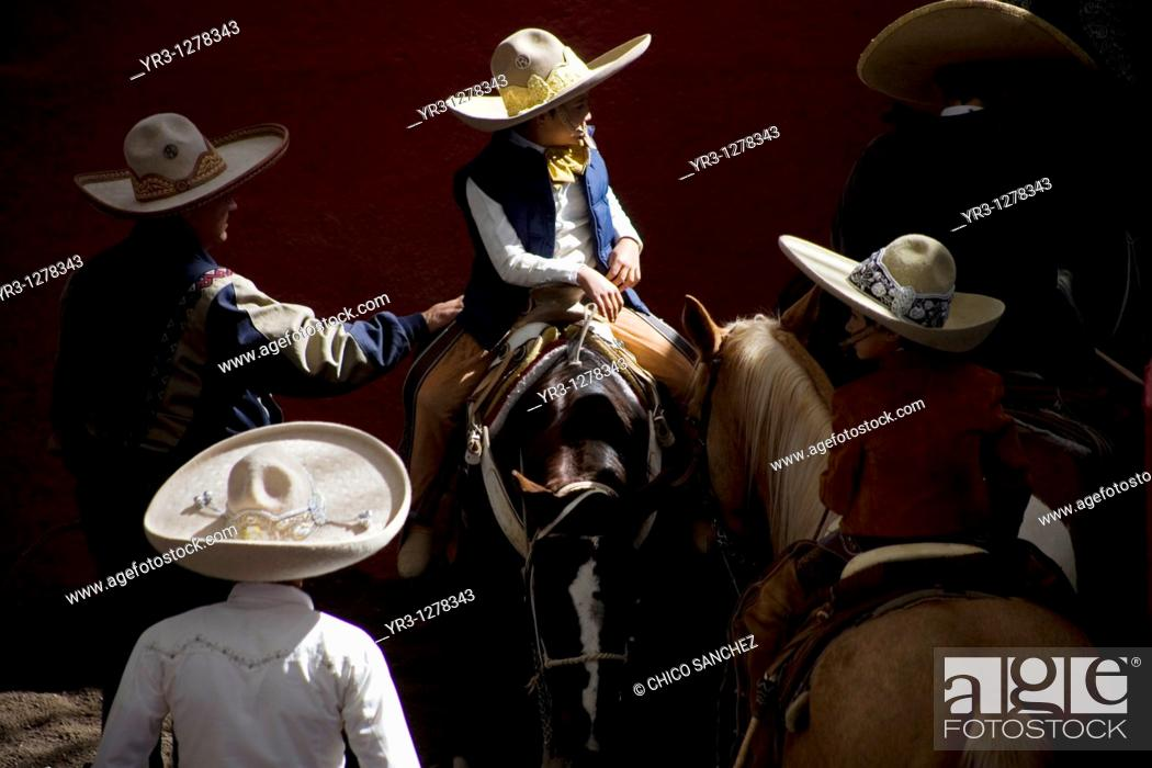 Stock Photo: Mexican charros visit at the National Charro Championship in Pachuca, Hidalgo State, Mexico. Escaramuzas are similar to US rodeos.