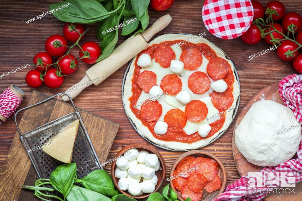Stock Photo: Pizza in the making.