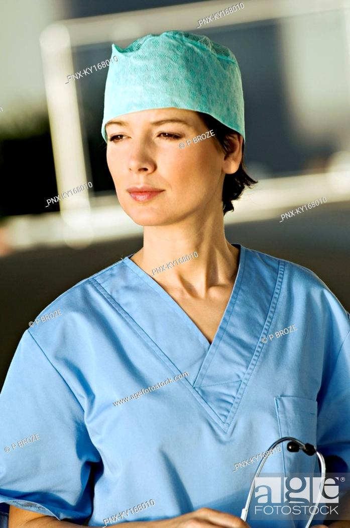 Stock Photo: Close-up of a female doctor holding a stethoscope.