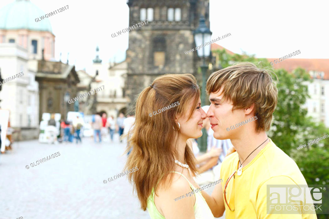 Stock Photo: Side profile of a young couple face to face.