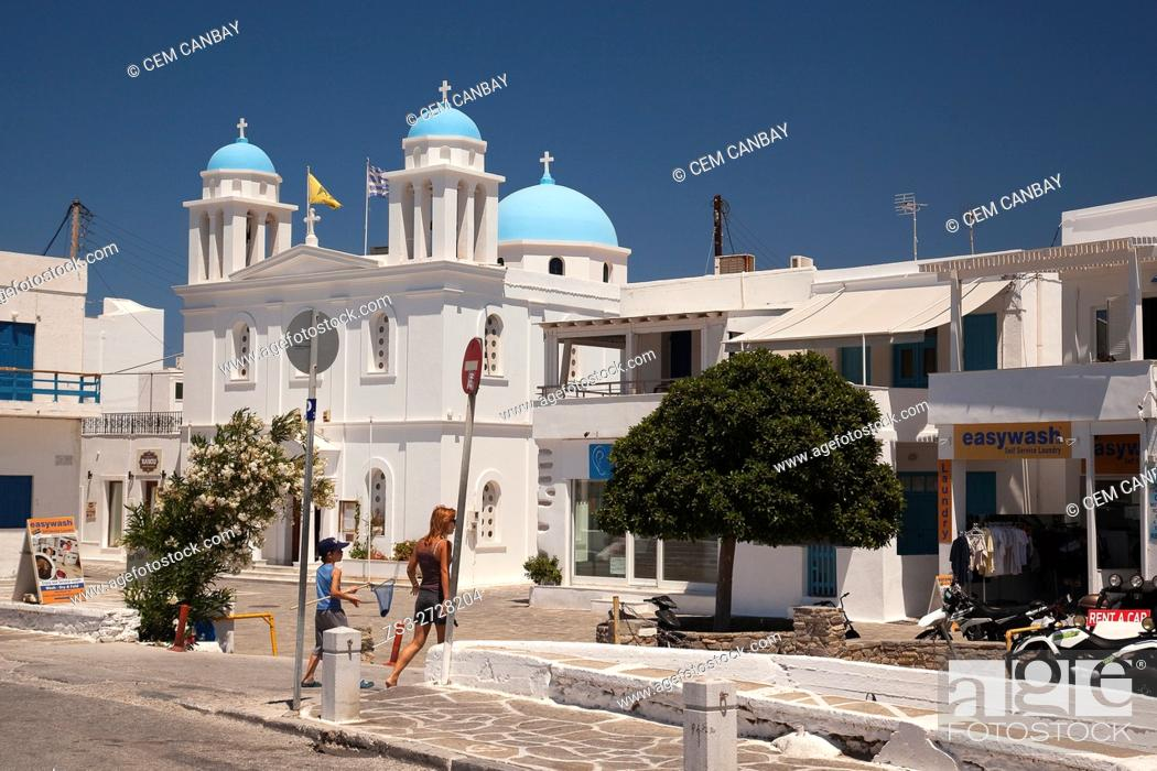 Stock Photo: Mother and child in front of the blue domed church in Parikia, Paros, Cyclades Islands, Greek Islands, Greece, Europe.