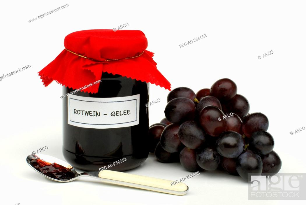 Stock Photo: Red wine jelly in glass and grapes spoon.