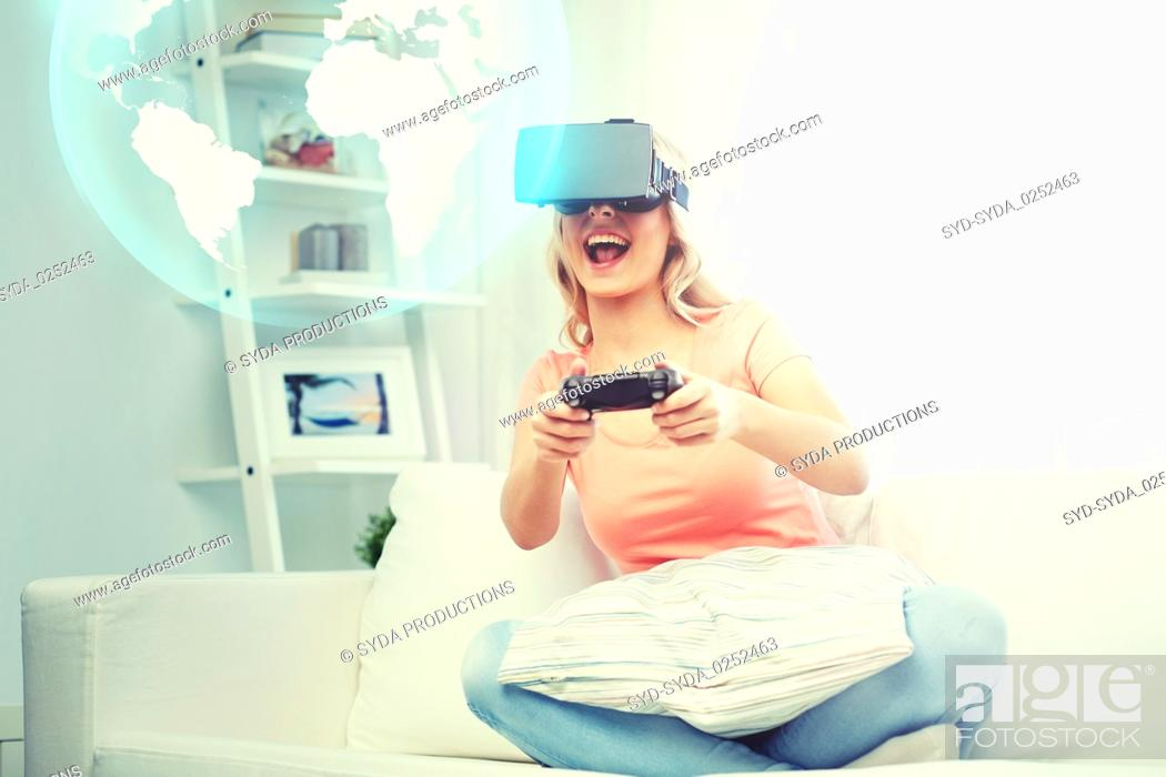 Stock Photo: woman in virtual reality headset with controller.
