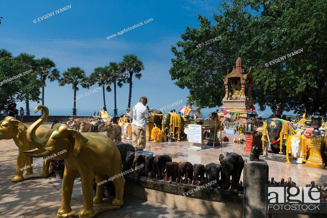 Stock Photo: Man praying in the shrine to elephants on Promthep cape, Phuket, Thailand.