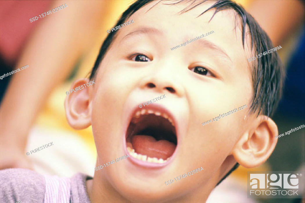 Stock Photo: Close-up of a boy with his mouth open.