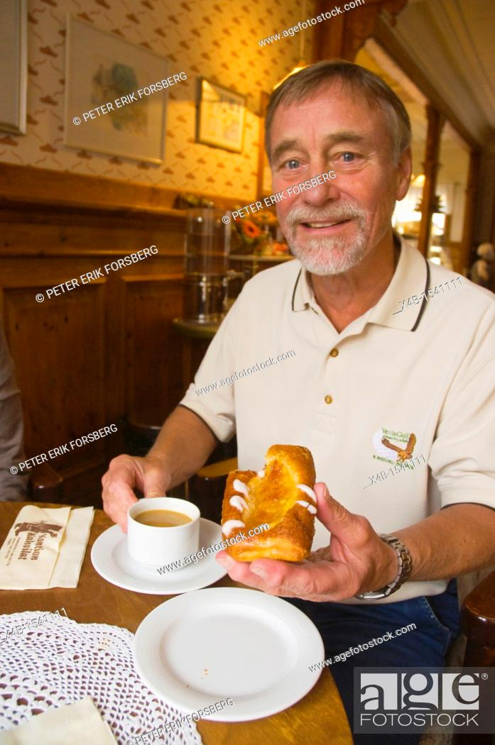Stock Photo: Man in his early 70s having coffee and cake Finland Europe.