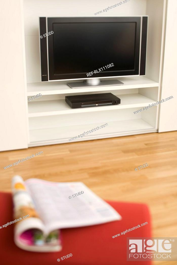 Stock Photo: Flat screen TV and magazine.