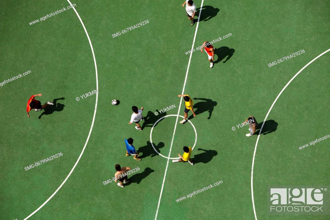 Stock Photo: Arial view of men playing soccar.