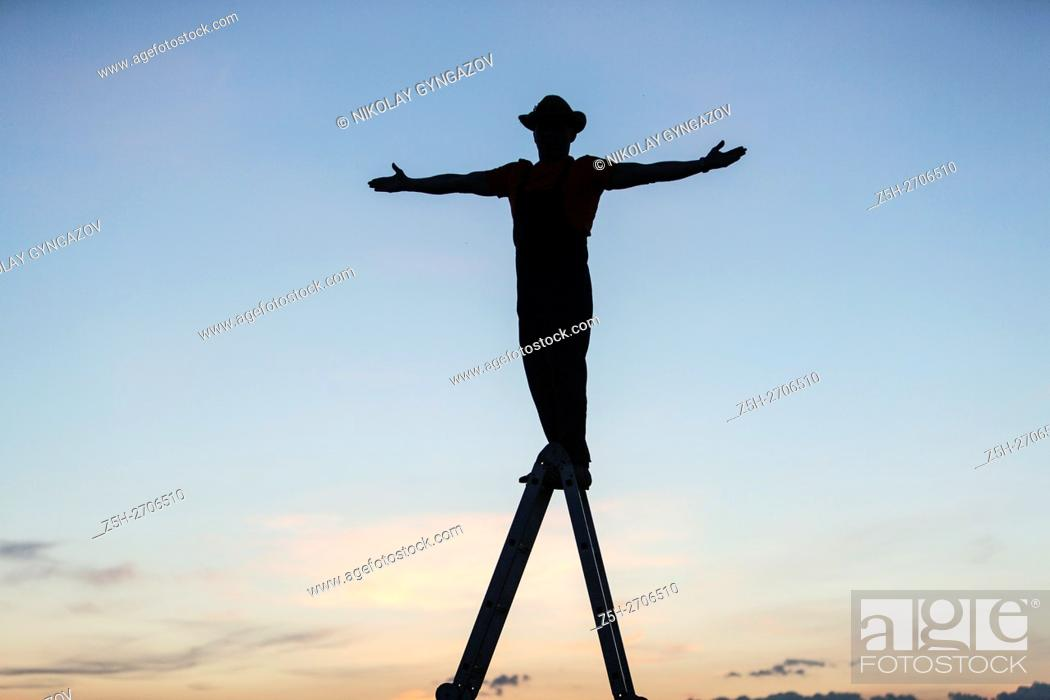 Stock Photo: Russia. The evening, the man against the sky.