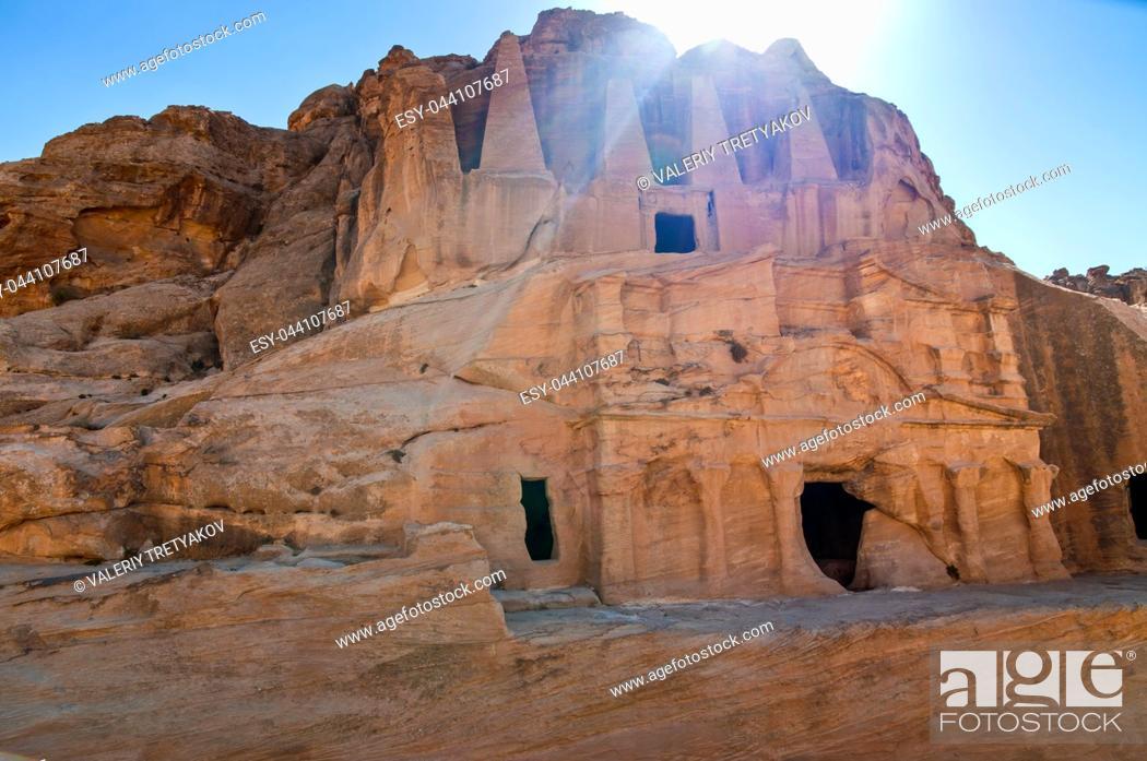 Stock Photo: Rock cut tombs in the ancient Nabataens (also Nabateans) city of Petra in Jordan - in backlight.
