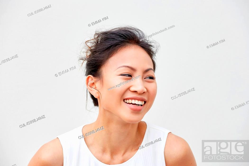 Stock Photo: Portrait of woman laughing.