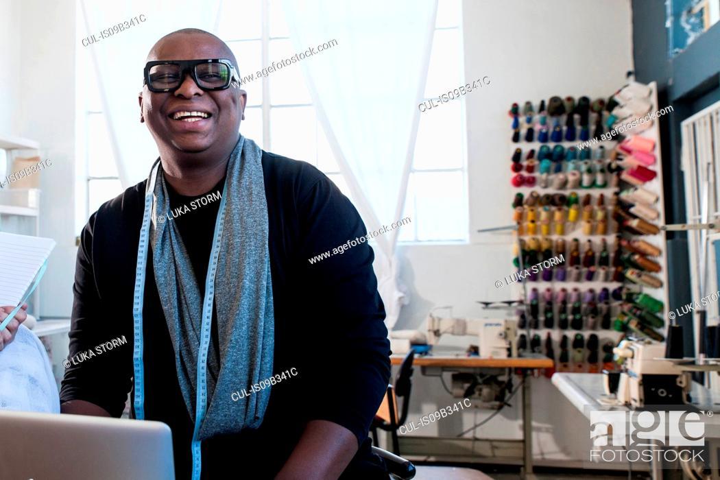 Stock Photo: Portrait of male fashion designer in design studio.