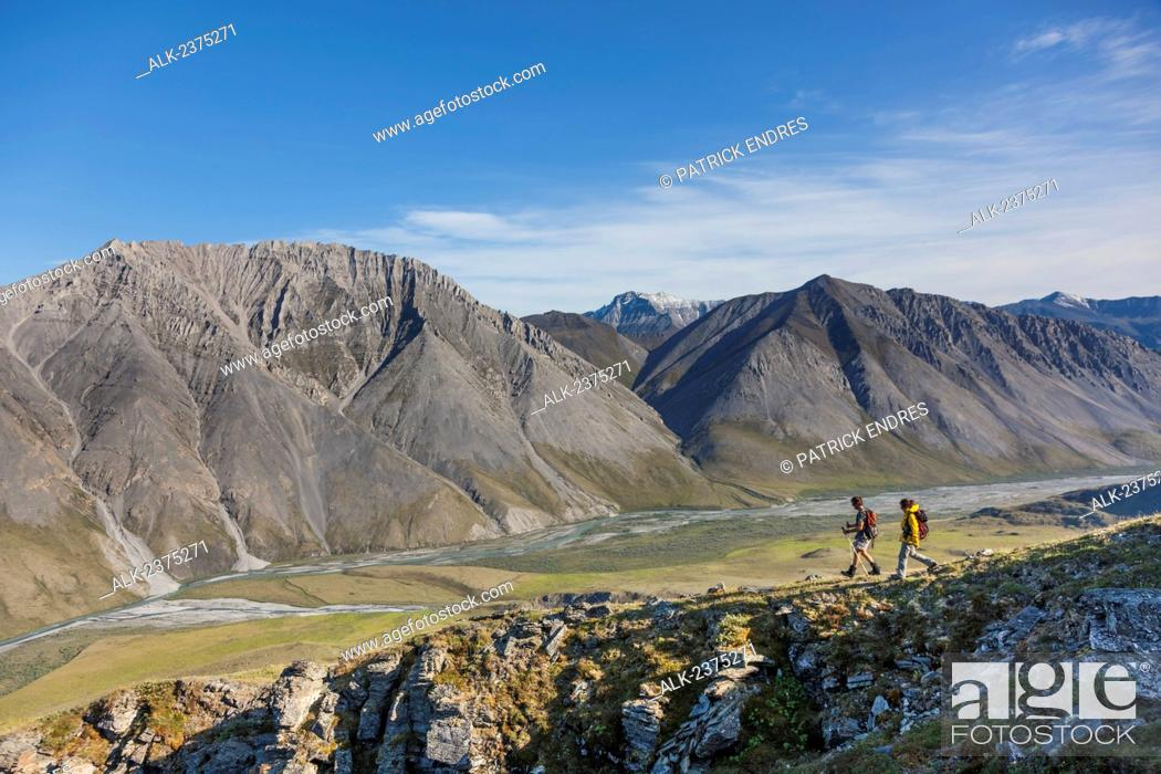 Stock Photo: Hikers in the mountains bordering the Marsh Fork of the Canning river in the Arctic National Wildlife Refuge, Brooks range mountains, Alaska.