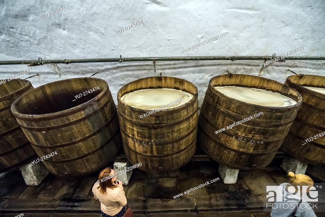 Stock Photo: Wooden open fermentation barrels in the historical cellars of Pilsner Urquell Brewery in Pilsen city, Czech Republic.