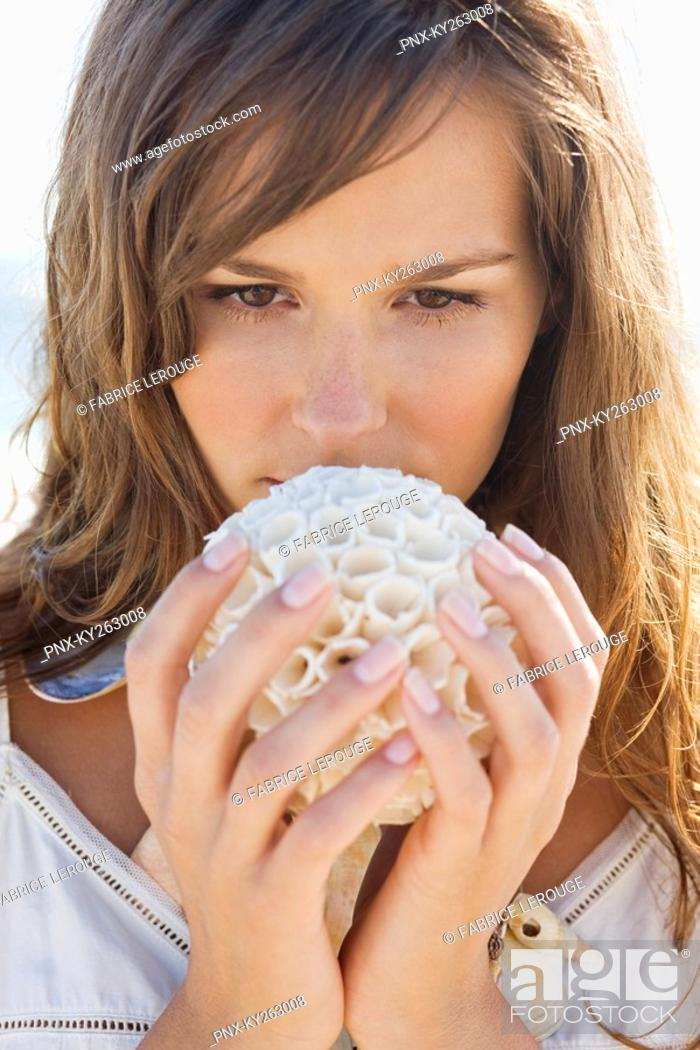 Stock Photo: Close-up of a woman holding a sea sponge.