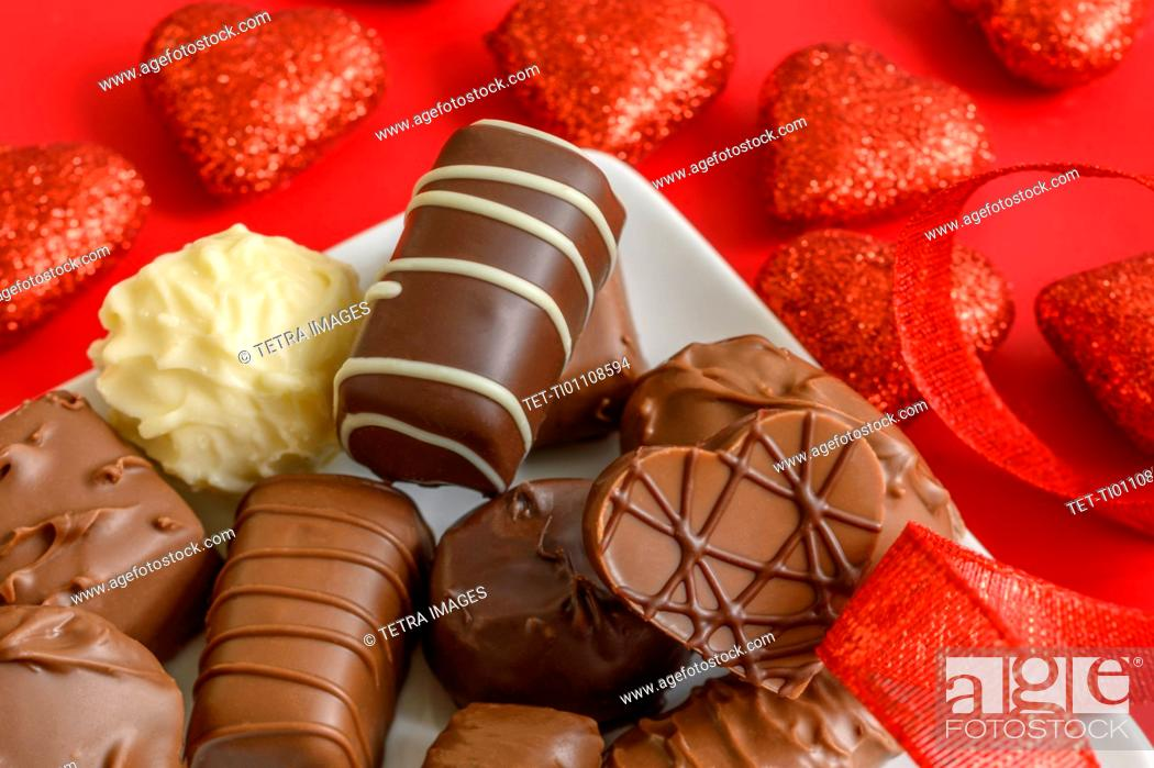 Photo de stock: Assorted chocolates with red hearts.