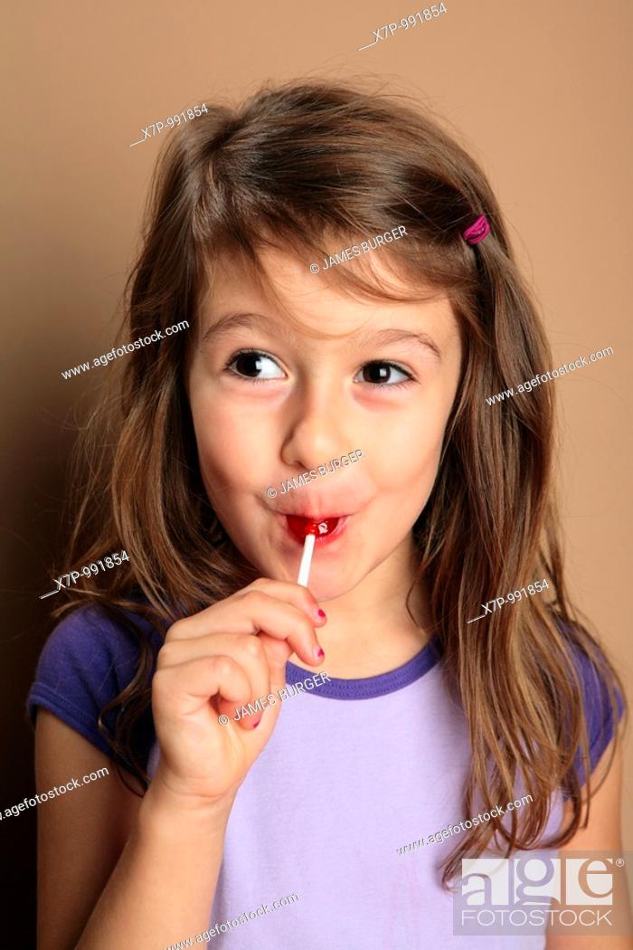 Stock Photo: Young girl with red lollipop candy.