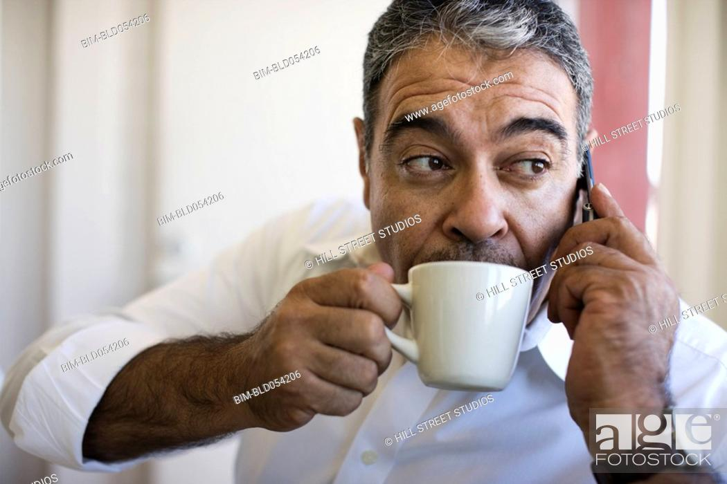 Stock Photo: Hispanic man drinking coffee.