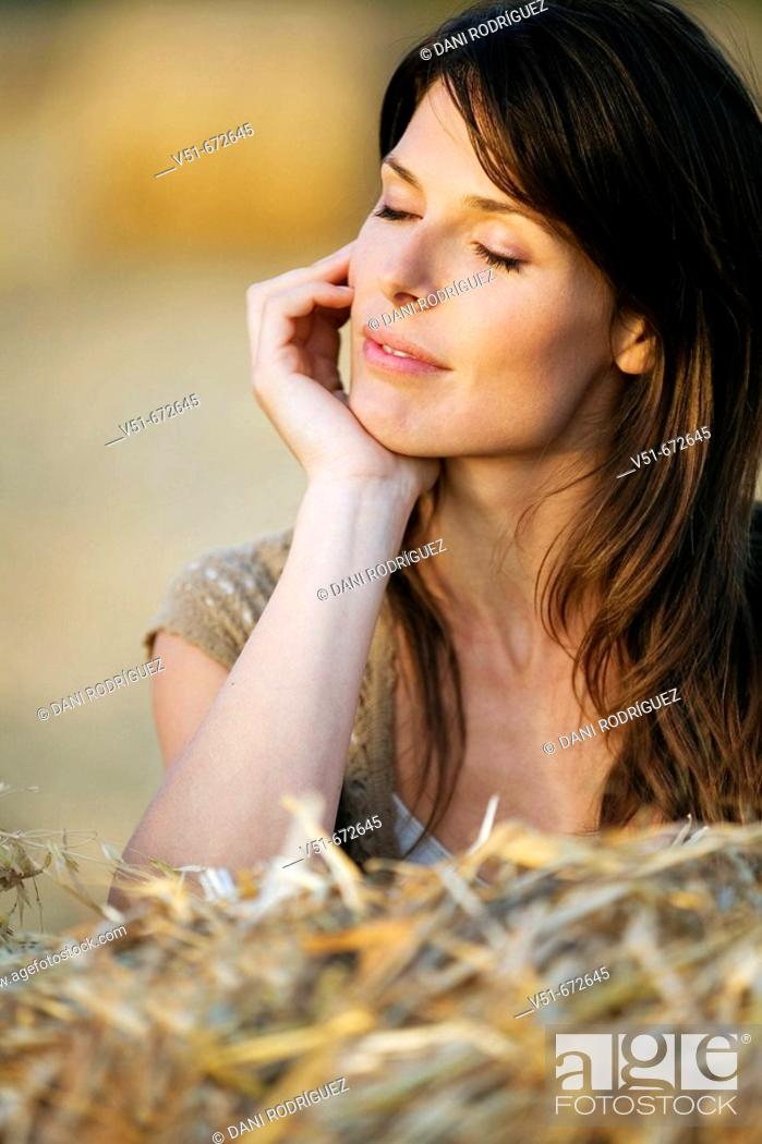 Stock Photo: Woman outdoors with eyes closed feeling good.