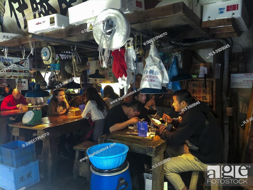 Imagen: Paris, France, People Sharing Meals inside Unusual Japanese Restaurant, 'Kodawari Ramen', Japanese Fish Market Design, ( Palais Royale Neighborhood).