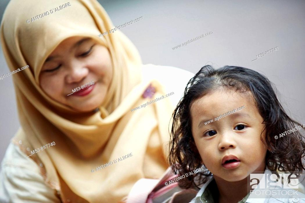 Stock Photo: a muslim mother with her young child  kuala lumpur  malaysia  asia.