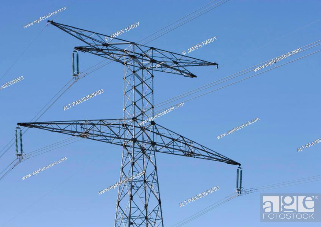 Stock Photo: Electric pylon, low angle view.