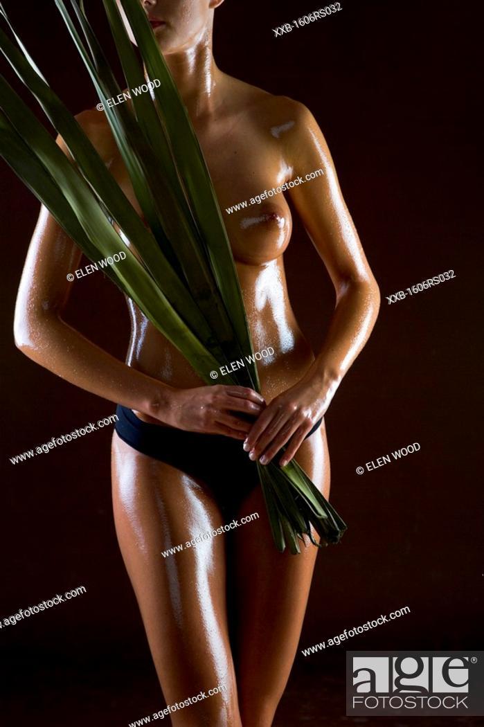 Stock Photo: woman body in oil.