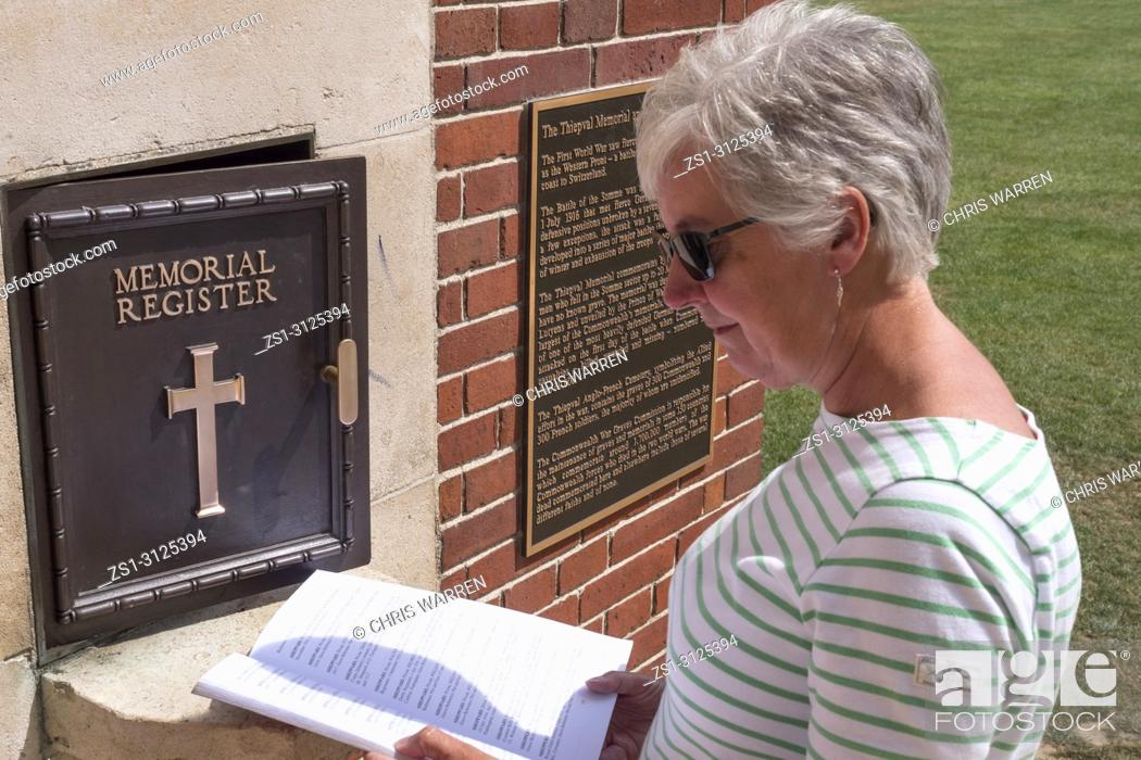 Stock Photo: Lady looking at War Graves Register Thiepval Memorial Thiepval Albert Peronne Somme Hauts-de-France France.