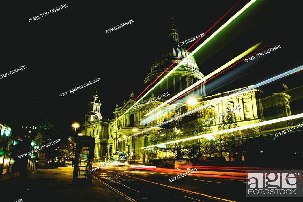 Stock Photo: Night view of traffic light trails passing in front of St Paul's Cathedral, London, England.