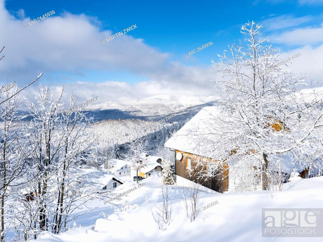 Stock Photo: Village Waldhaeuser in the National Park Bavarian Forest (Bayerischer Wald) in the deep of winter. View towards mount Rachel and mount Falkenstein.