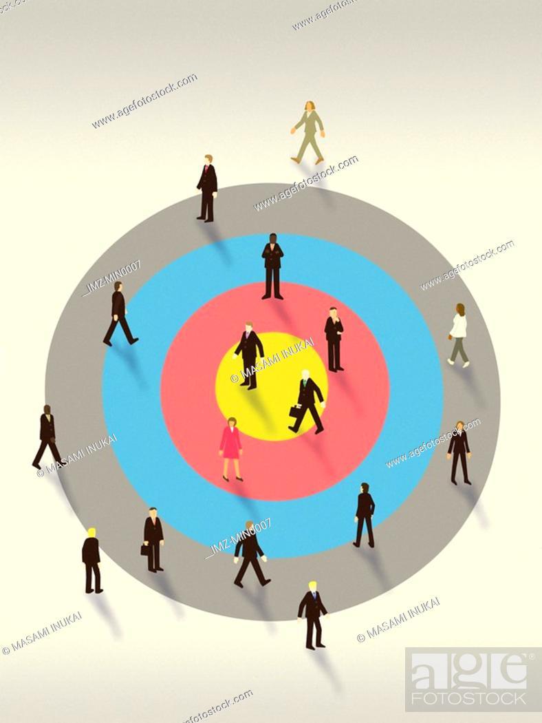 Stock Photo: Business people walking on top of a bulls eye target.
