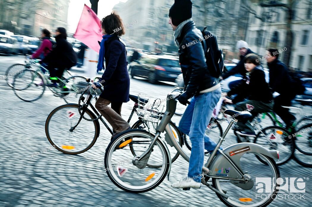 Stock Photo: People on cycles  Paris, France, Europe.