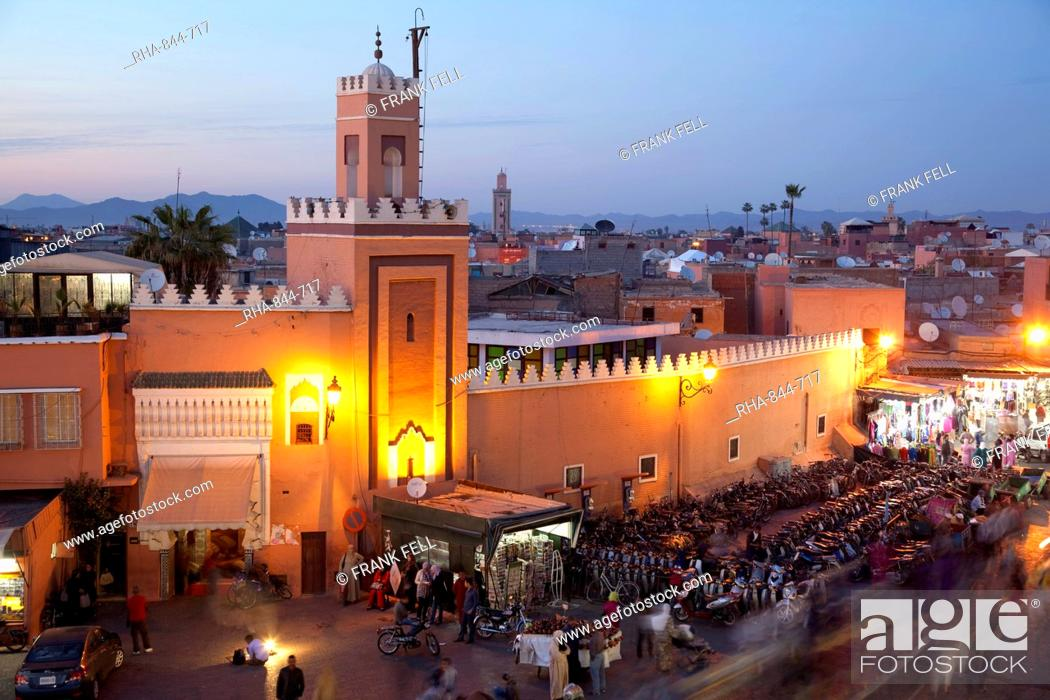 Stock Photo: Mosque at dusk, Place Jemaa El Fna, Marrakesh, Morocco, North Africa, Africa.