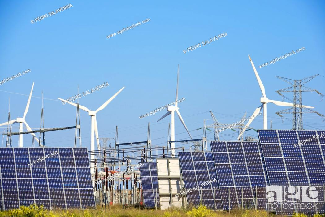 Stock Photo: Windmills and photovoltaic panels for energy production, Navarra, Spain.