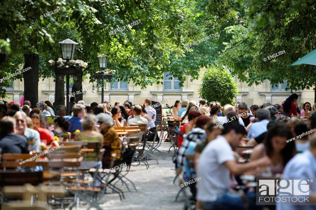 Stock Photo: Large group of people in beer garden, Munich, Bavaria, Germany.