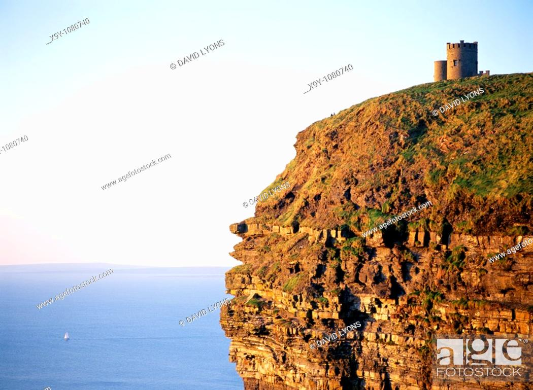 Stock Photo: O'Brien's Tower on top of the sheer Cliffs of Moher, County Clare, west Ireland  Sailboat yacht in distance  Atlantic Ocean.