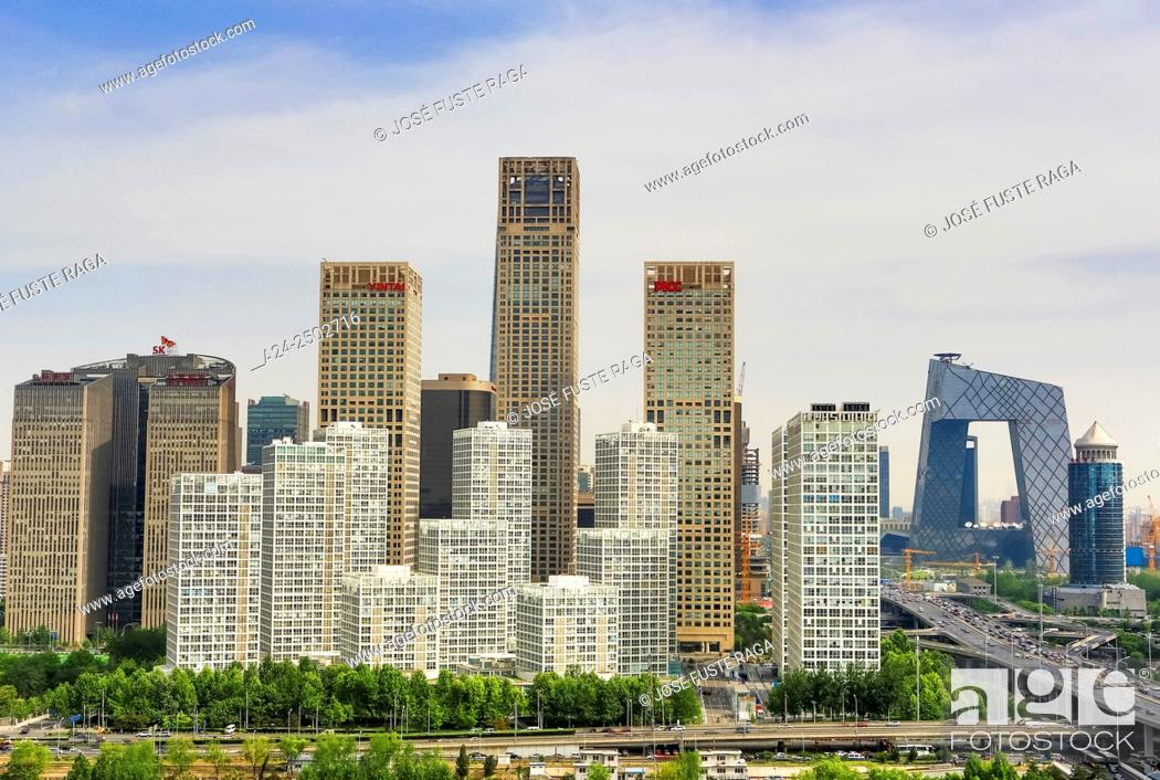 Stock Photo: China, Beijin City, Guomao District skyline, East second ring road, CCTV Headquarters Bldg.