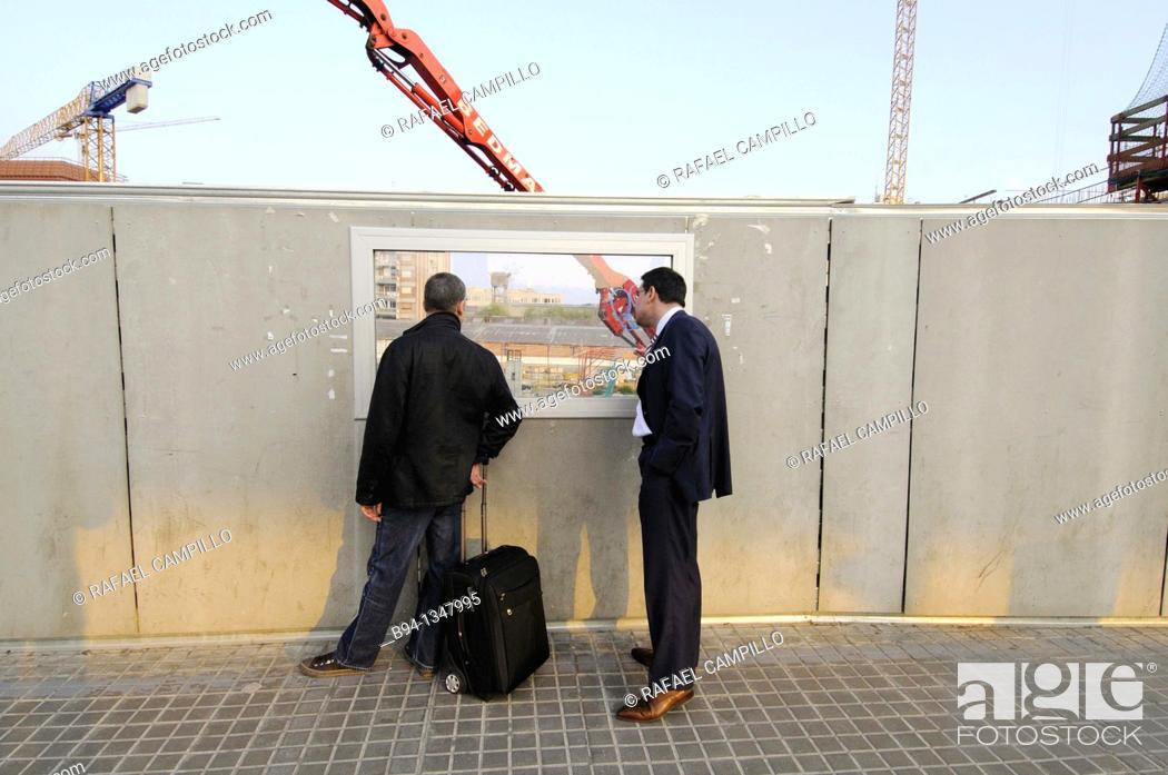 Stock Photo: Men looking at construction site, Plaça de les Glories, Barcelona, Catalonia, Spain.