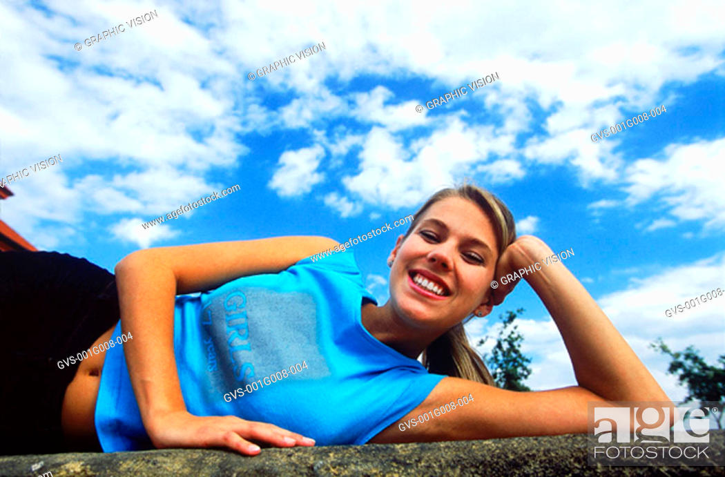 Stock Photo: Young woman exercising outdoors.