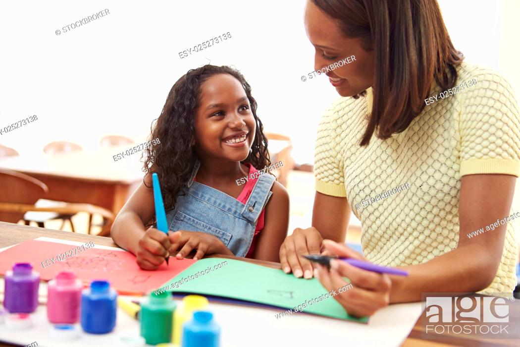 Stock Photo: Mother Painting Picture With Daughter At Home.