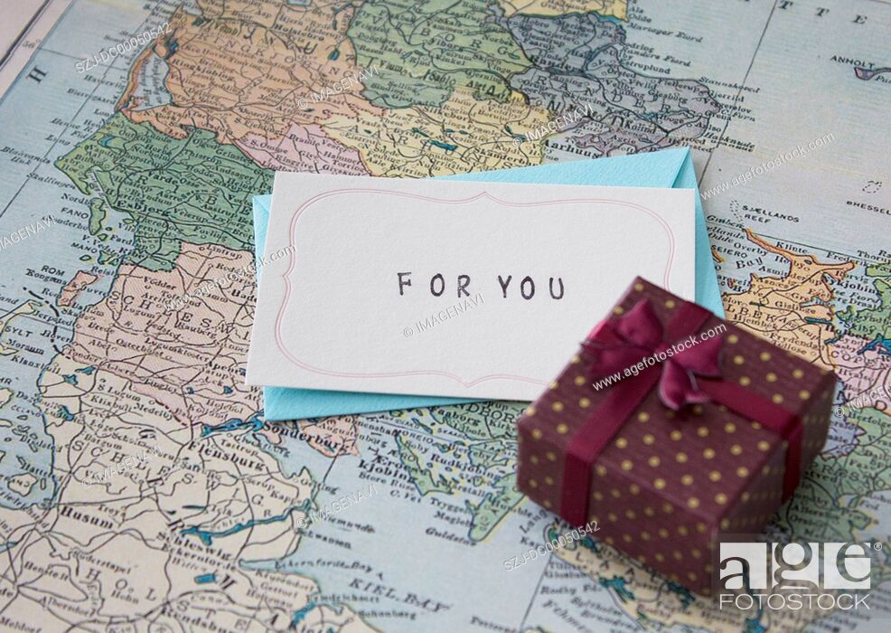 Stock Photo: Gift box and a letter on a map.