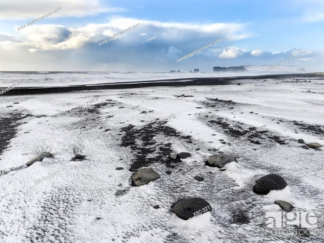 Stock Photo: The coast of the north atlantic near Vik y Myrdal during winter. Black volcanic beach Reynisfjara, view towards Dyrholaey.