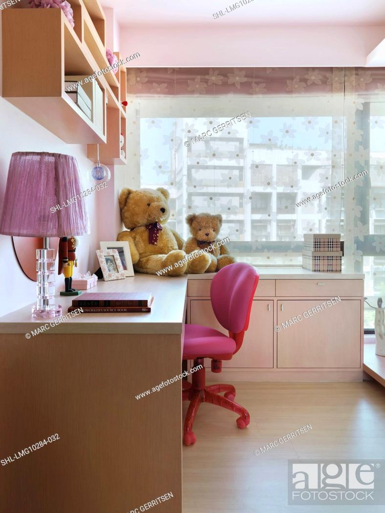 Amazing Pink Desk Chair At Desk In Kids Bedroom Stock Photo Creativecarmelina Interior Chair Design Creativecarmelinacom
