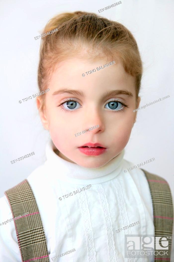 Photo de stock: Beautiful preschooler blue eyes portrat with school dress.