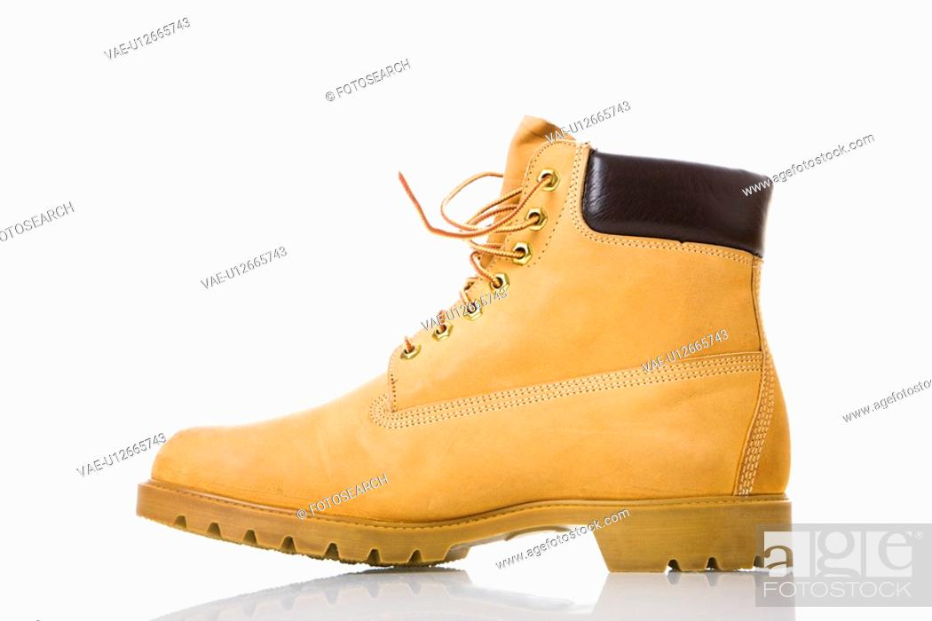 Stock Photo: One tan work boot.