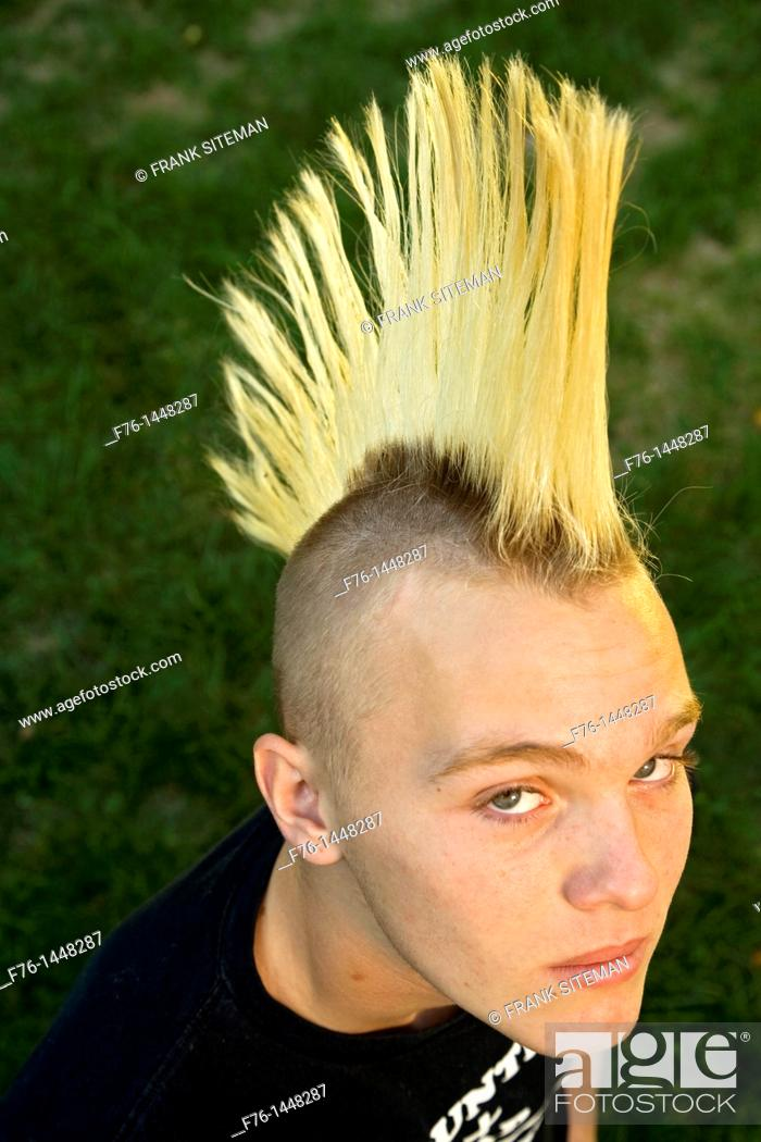 14 Year Old Teenage Boy With Bleached Hair And A Spiked Mohawk