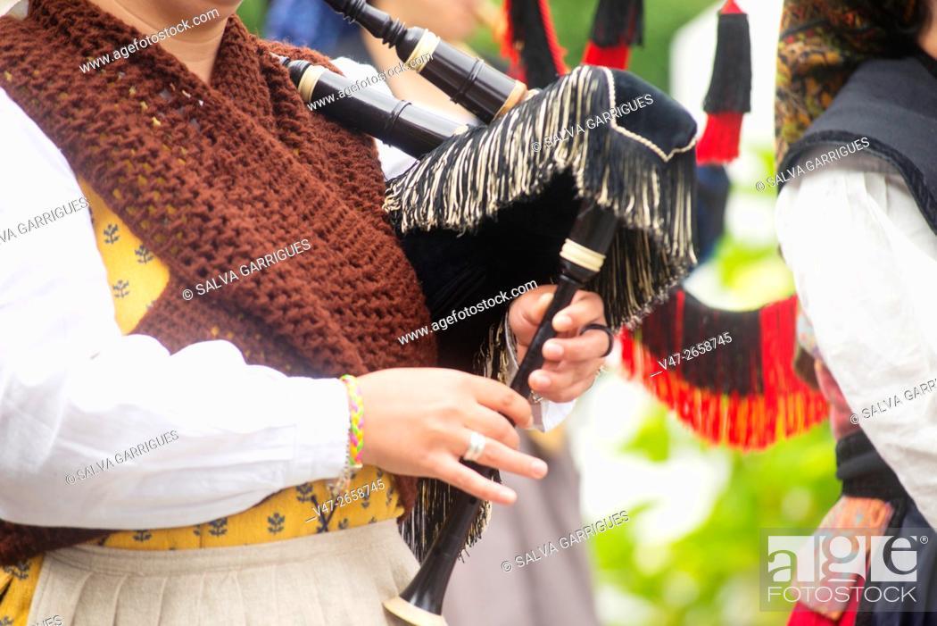Stock Photo: Bagpipes band parade through the streets of Muros del Nalon, Asturias, Spain, Europe.