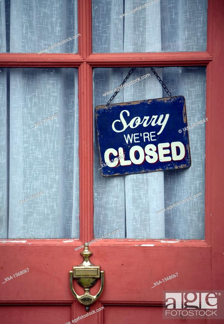 Stock Photo: Old fashioned 'Sorry we're Closed' sign in window of closed down village shop.