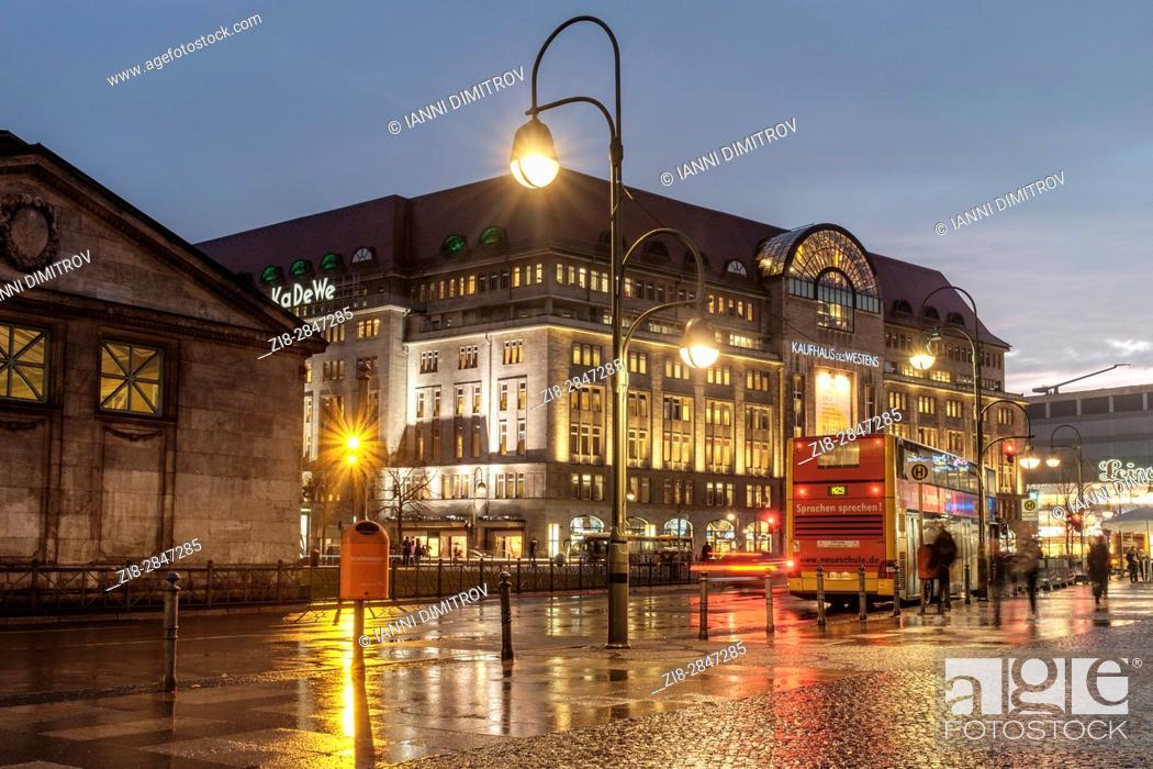 Stock Photo: Germany, Berlin, Wittenbergplatz (Wittenberg Square), Tauentzienstrasse. Berlin's largest department store, KaDeWe on a rainy evening.